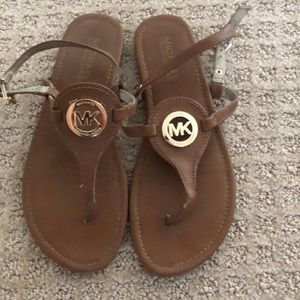 Michael Kors Brown Sandals with gold signage